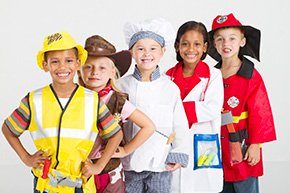 Kids dressed up in career outfits